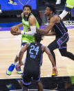 Minnesota Timberwolves center Karl-Anthony Towns (32) drives to the basket as he's defended by Sacramento Kings center Hassan Whiteside (20) and guard Buddy Hield (24 )during the first quarter of an NBA basketball game in Sacramento, Calif., Wednesday, April 21, 2021. (AP Photo/Hector Amezcua)