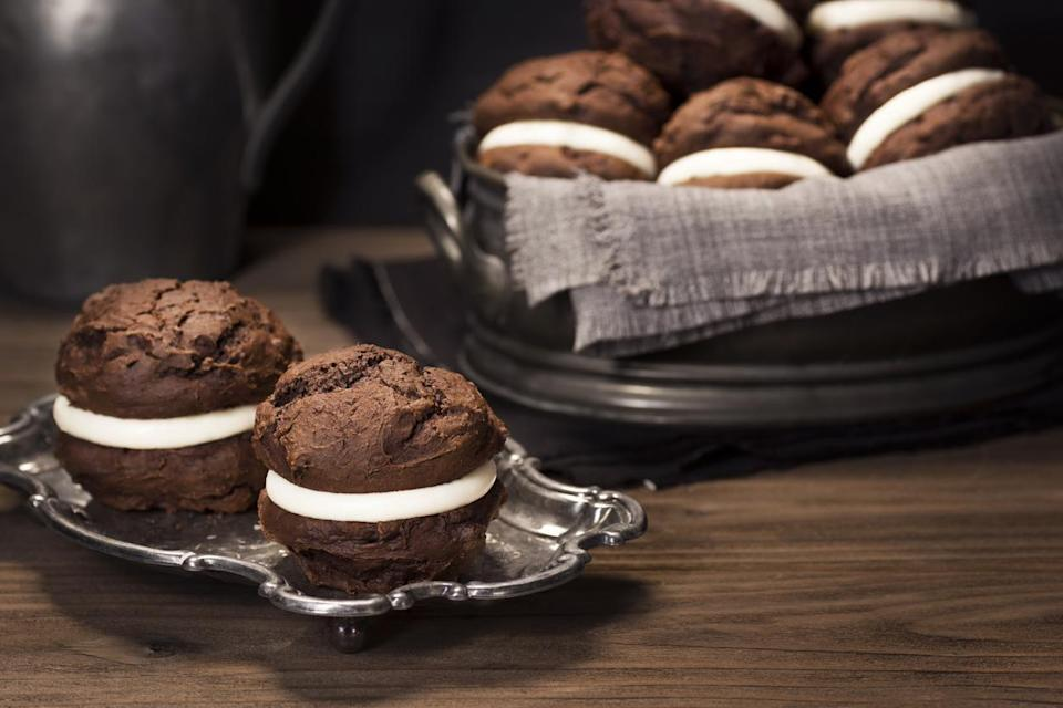 "<p>New Hampshire is one of a few states to lay claim to inventing the whoopie pie, including Maine, where it is the state's <a href=""https://www.thedailymeal.com/eat/snack-food-every-state?referrer=yahoo&category=beauty_food&include_utm=1&utm_medium=referral&utm_source=yahoo&utm_campaign=feed"" rel=""nofollow noopener"" target=""_blank"" data-ylk=""slk:most iconic snack"" class=""link rapid-noclick-resp"">most iconic snack</a>. But plenty of New Hampshire bakeries are famous for their whoopie pies. One bakery, Just Like Mom's Pastries in Weare, New Hampshire, has over 50 individual flavors of the treat, which traditionally is served with vanilla cream filling sandwiched between two chocolate cakes.</p>"