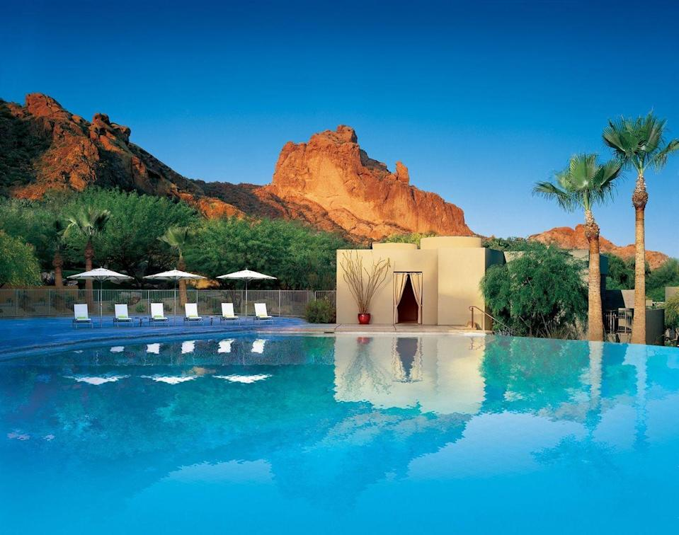 "<p>The ultimate golf and spa destination feels like the perfect place to spend the weekend with your person. This unique suburb of Phoenix offers stellar hiking, shopping, arts, and cuisine, leaving you with the ultimate sensory experience.</p><p>Find rest and rejuvenation at <a href=""https://www.sanctuaryoncamelback.com/"" rel=""nofollow noopener"" target=""_blank"" data-ylk=""slk:Sanctuary on Camelback Mountain Resort & Spa"" class=""link rapid-noclick-resp"">Sanctuary on Camelback Mountain Resort & Spa</a>, where luxury is always surrounded by natural wonders. Opt for one of the secluded Spa Casitas and enjoy the Romance in Paradise package offering rose petal turndown service, Champagne and chocolate-covered strawberries, dinner at its signature restaurant, and a private outdoor soaking tub for two. And that's all before you book your couples spa treatments!</p>"