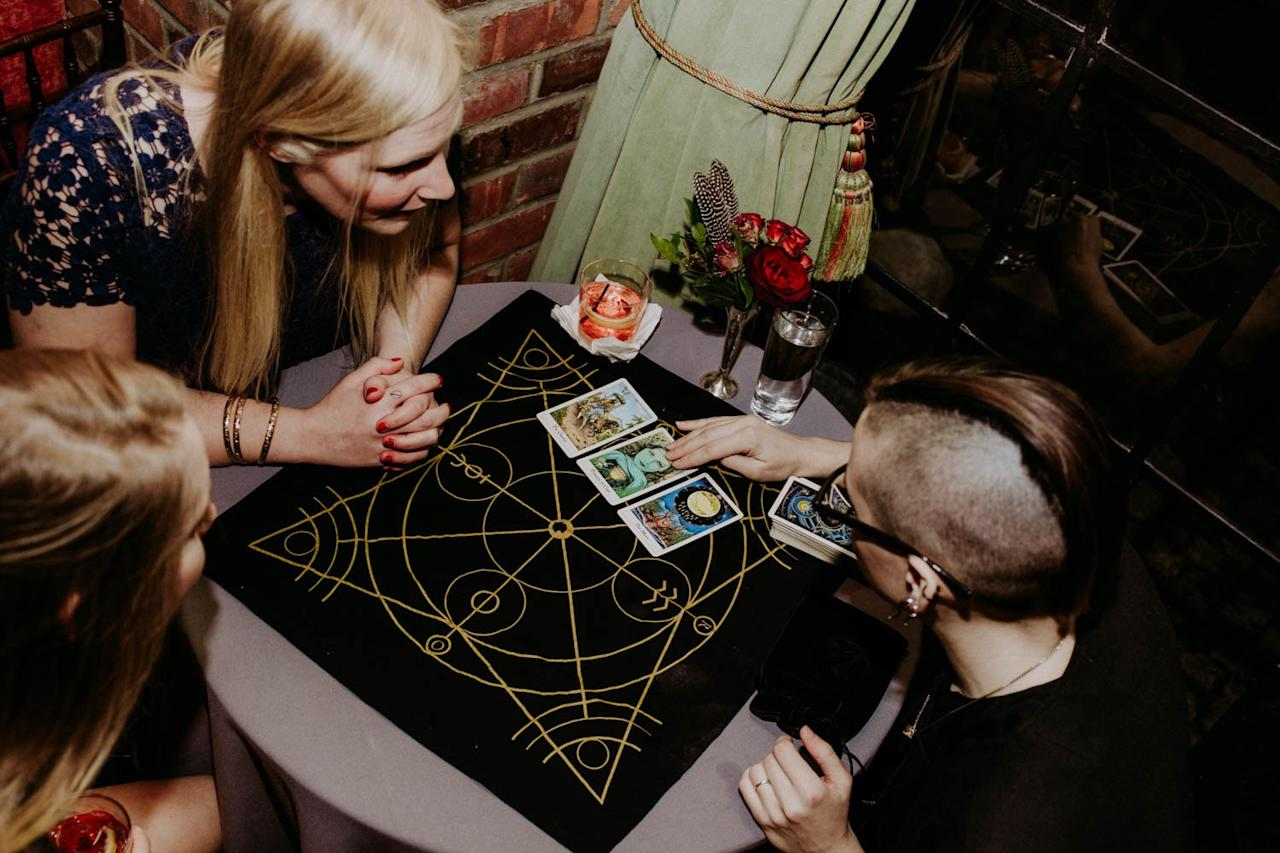 As a unique wedding reception activity, hire a tarot card reader to give guests glimpses into their future.