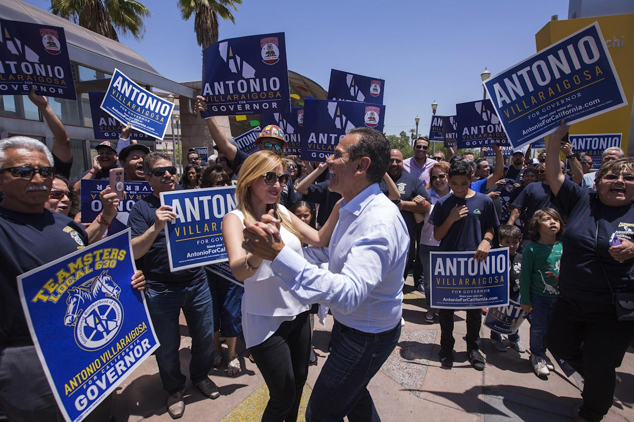 Democratic gubernatorial candidate Antonio Villaraigosa dances at Mariachi Plaza in his childhood Los Angeles neighborhood of Boyle Heights as he campaigns in the run-up to the primary election, on June 2, 2018. (Photo: David McNew/Getty Images)