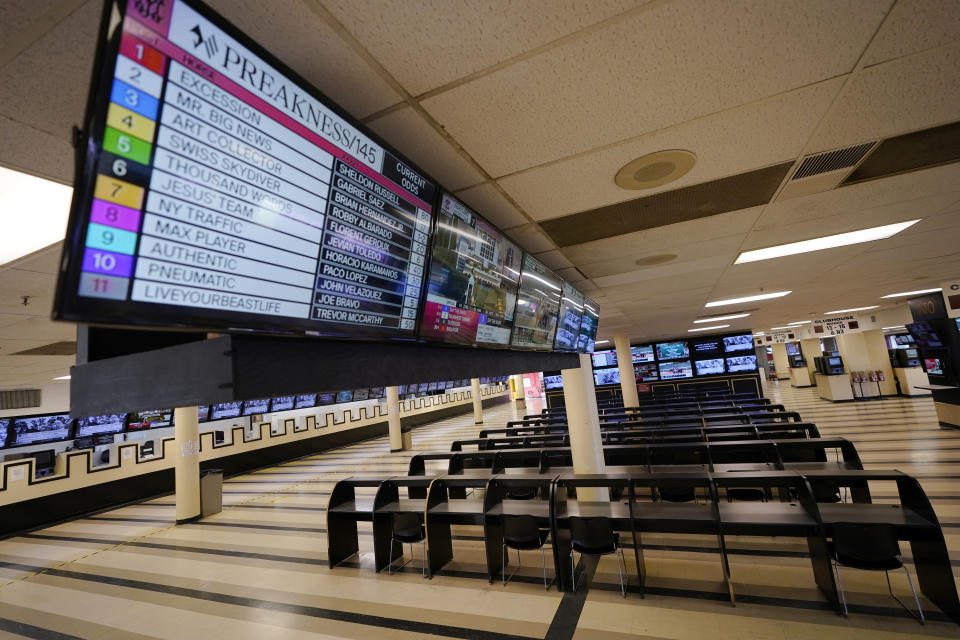 FILE - In this Oct. 2, 2020, file photo, betting tables are empty at Pimlico Race Course in Baltimore. Pimlico, which opened in 1870, is set to be rebuilt over the next two-plus years. (AP Photo/Steve Helber, File)