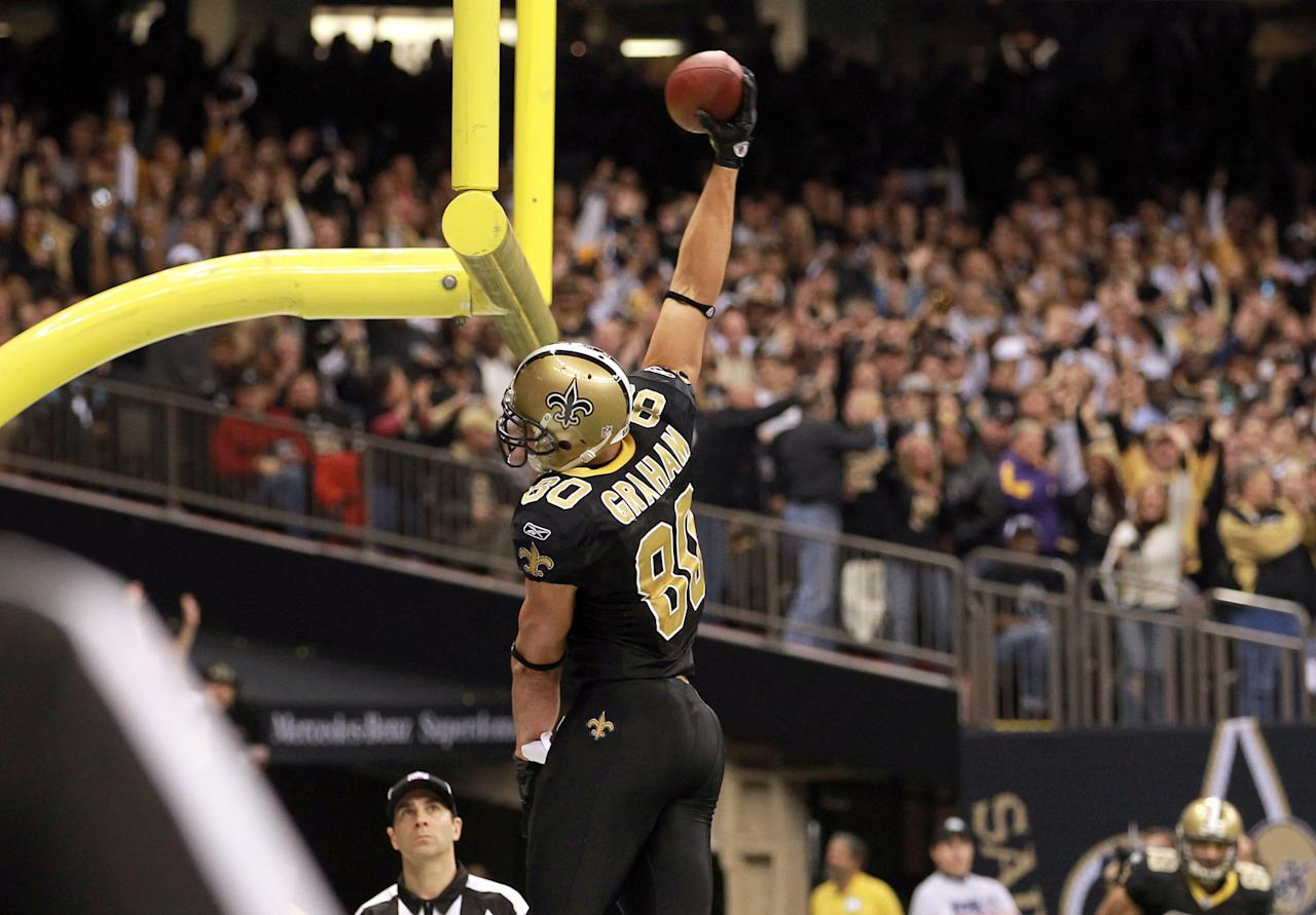 NEW ORLEANS, LA - NOVEMBER 28:  Tight end  Jimmy Graham #80 of the New Orleans Saints slams the ball over the goal post after his five-yard touchdown catch in the second quarter against the New York Giants at Mercedes-Benz Superdome on November 28, 2011 in New Orleans, Louisiana.  (Photo by Ronald Martinez/Getty Images)