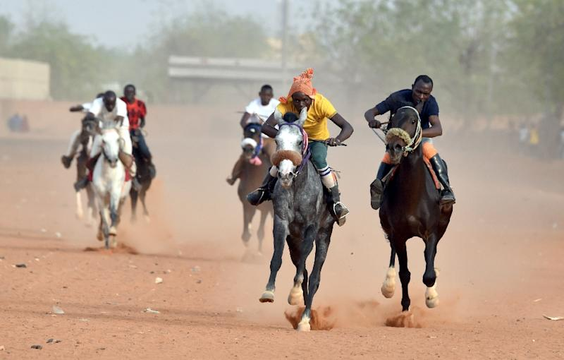 Nigerien Jockeys Compete During A Horse Race At The Hippodrome Of Niamey
