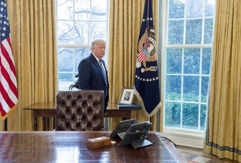 A photograph of President Donald Trump's father, Fred Trump, sits behind the Resolute Desk in the Oval Office.