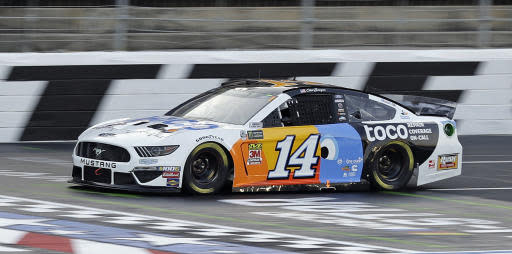 Clint Bowyer drives during qualifying for Saturday's NASCAR All-Star auto race at Charlotte Motor Speedway in Concord, N.C., Friday, May 17, 2019. Bowyer won the pole position for the race. (AP Photo/Chuck Burton)