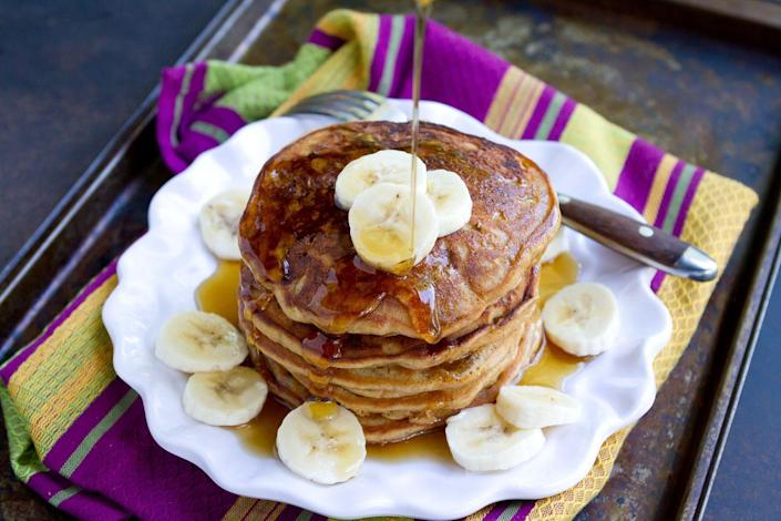 """<p>This classic breakfast food is even more delicious atop a short stack! Although not Ree's favorite, fresh bananas balance out the bread-yness of pancakes perfectly. </p><p><strong>Get the recipe from <a href=""""https://www.thepioneerwoman.com/food-cooking/recipes/a102692/pbj-banana-pancakes/"""" rel=""""nofollow noopener"""" target=""""_blank"""" data-ylk=""""slk:Dara Michalski"""" class=""""link rapid-noclick-resp"""">Dara Michalski</a>. </strong></p><p><strong><a class=""""link rapid-noclick-resp"""" href=""""https://go.redirectingat.com?id=74968X1596630&url=https%3A%2F%2Fwww.walmart.com%2Fbrowse%2Fhome%2Fplates%2F4044_623679_639999_2113437&sref=https%3A%2F%2Fwww.thepioneerwoman.com%2Ffood-cooking%2Fmeals-menus%2Fg36146701%2Fbest-pancake-toppings%2F"""" rel=""""nofollow noopener"""" target=""""_blank"""" data-ylk=""""slk:SHOP PLATES"""">SHOP PLATES</a><br></strong></p>"""