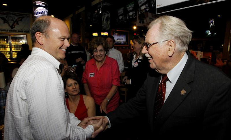 FILE - In this April 3, 2012 file photo, Rep. Roscoe Bartlett, R-Md., right, shakes hands with Terry Allen as he awaits the primary election results in Frederick, Md. Thanks for your service, and good luck. That's what the national parties are saying to congressional veterans like Bartlett, Rep. David Rivera, R-Fla. and Rep. Larry Kissell, D-N.C. (AP Photo/Luis M. Alvarez, File)