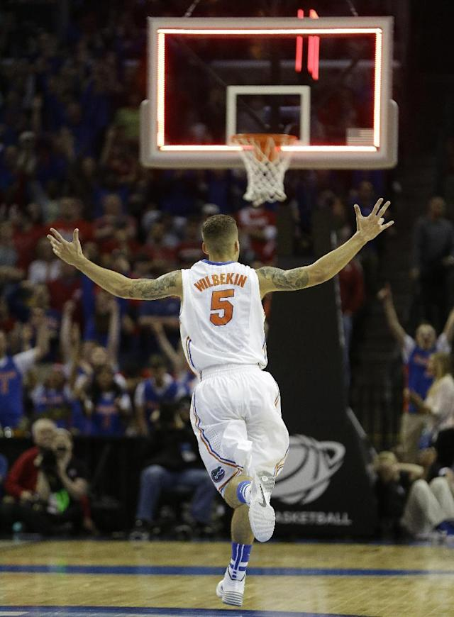 Florida guard Scottie Wilbekin (5) celebrates his basket against Dayton during the first half in a regional final game at the NCAA college basketball tournament, Saturday, March 29, 2014, in Memphis, Tenn. (AP Photo/Mark Humphrey)