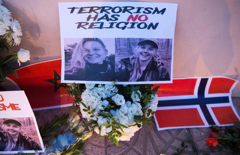 Flowers, pictures and flags in tribute to two young Scandinavian women killed while hiking in Morocco in December 2018 (AFP Photo/FADEL SENNA)