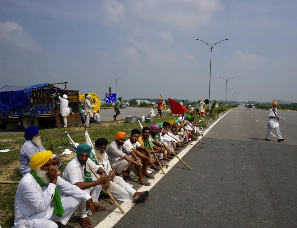 Protesting farmers gather at Singhu, outskirts of New Delhi, India, Monday, Sept.27, 2021. Thousands of Indian farmers Monday blocked traffic on major roads and railway tracks outside of the nation's capital, calling on the government to rescind agricultural laws that they say will shatter their livelihoods. The farmers called for a nation-wide strike to mark one year since the legislation was passed, marking a return to protests that began over a year ago. (AP Photo/Manish Swarup)
