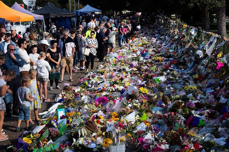 There has been an outpouring of grief in New Zealand in the week since the attack (AFP Photo/Marty MELVILLE)