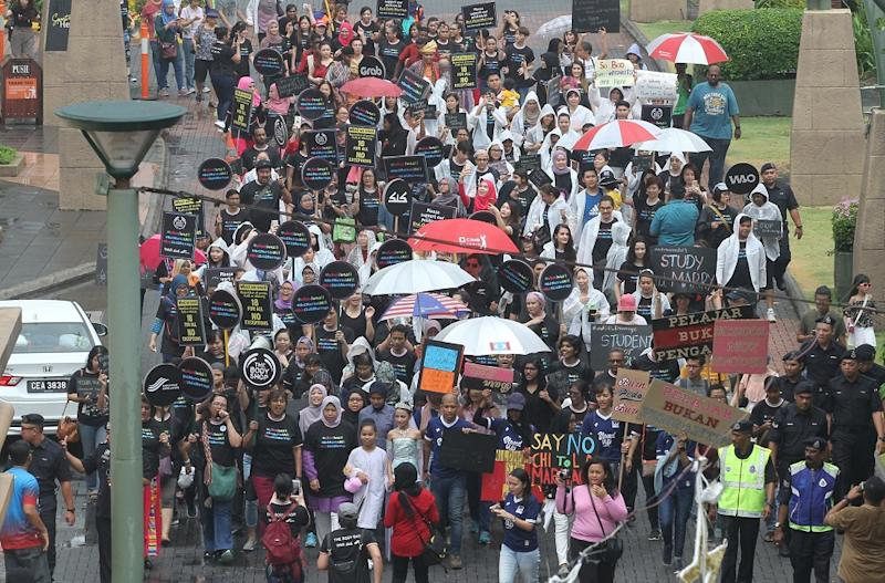 Around 200 people rallied against child marriages, in Bandar Sunway August 18 2018. — Pictures by Abdul Razak Ghazali