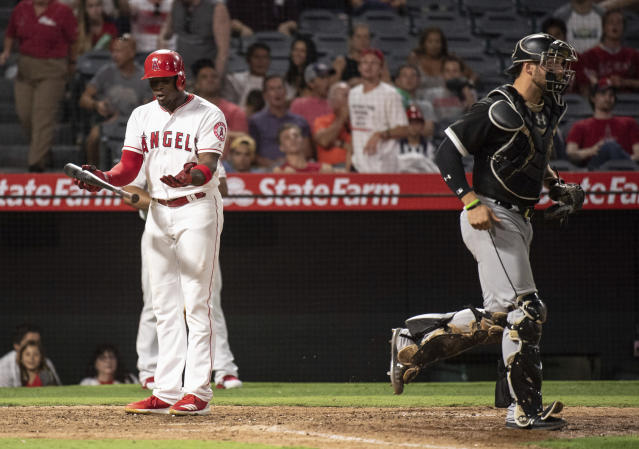 Los Angeles Angels' Justin Upton, left, argues to the home plate umpire after getting struck out to end the baseball game against the Chicago White Sox in Anaheim, Calif., Monday, July 23, 2018. Chicago won 5-3. (AP Photo/Kyusung Gong)