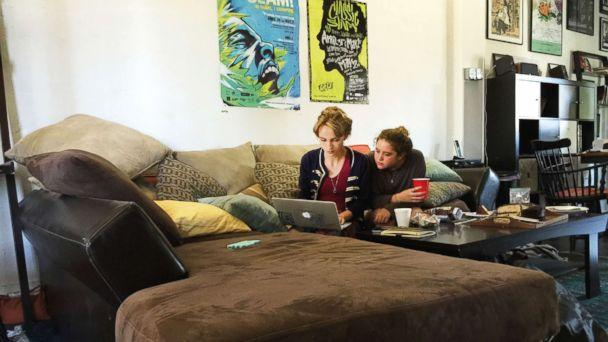 PHOTO: Rhiannon McGavin 17, and Miriam Sachs, members of Get Lit, polish a word poem during a Saturday working session. The time Get Lit poets were finalists in a competition, they third in the world. (Paola Gianturco)