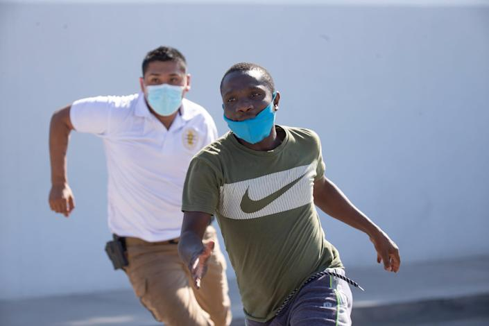 A Haitian immigrant is chased by Mexican officials in Ciudad Acuña as Instituto Nacional de Migración begins to detain migrants in the border city.