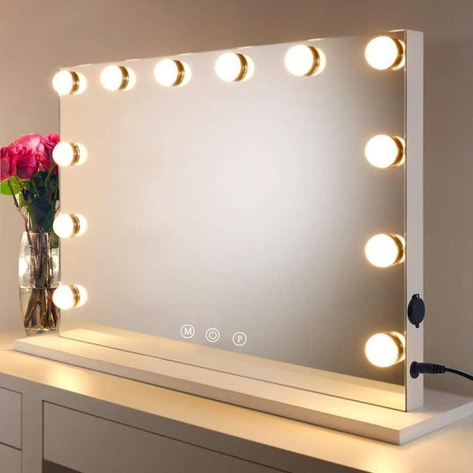 <p>With three color modes and touch control, the <span>HOMPEN Large Vanity Mirror Makeup Mirror with 12 Dimmable LED Bulbs</span> ($113) can either sit on your vanity or be wall-mounted. It's a great mirror for those who want a horizontally oriented mirror rather than vertical.</p>