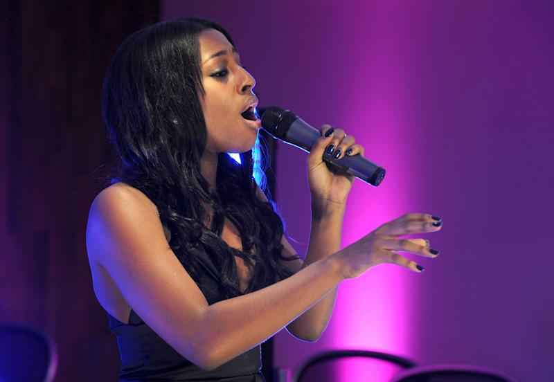X Factor Finalists Perform A Secret Gig At The Carphone Warehouse Store, Oxford Street, London, Britain - 01 Dec 2008, Alexandra Burke (Photo by Brian Rasic/Getty Images)