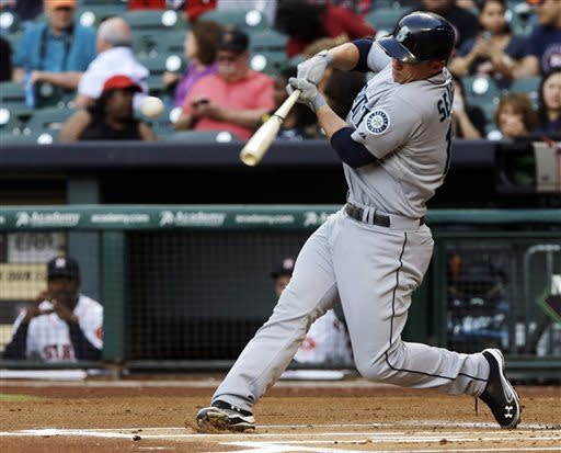 Seattle Mariners' Kyle Seager connects for a single against the Houston Astros in the first inning of a baseball game Monday, April 22, 2013, in Houston. (AP Photo/Pat Sullivan)