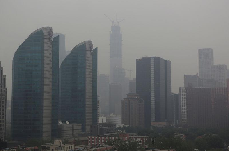 The construction site of China Zun, should be the tallest building in Beijing is seen in smog