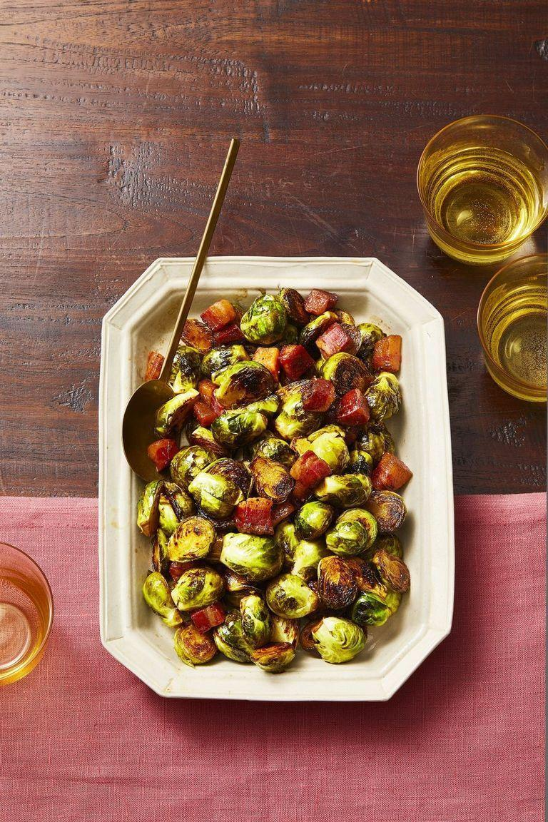 """<p>Slab bacon is much different than traditional bacon; it's chewier and more robust, which pairs well with crisp Brussels sprouts. A spritz of balsamic vinegar seals the deal on this flavorful side.</p><p><a href=""""https://www.goodhousekeeping.com/food-recipes/a29427548/bacon-brussels-sprouts-recipe/"""" rel=""""nofollow noopener"""" target=""""_blank"""" data-ylk=""""slk:Get the recipe for Brussels Sprouts With Heaps of Bacon »"""" class=""""link rapid-noclick-resp""""><em><em>Get the recipe for Brussels Sprouts With Heaps of Bacon <em><em>»</em></em></em></em></a></p>"""