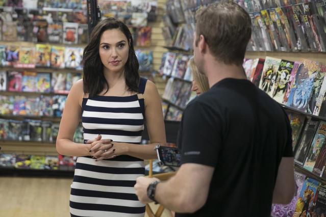 <p>Yahoo News' Brad Williams shares ideas about the shoot with actress Gal Gadot at the Midtown Comics in New York City. (Gordon Donovan/Yahoo News) </p>