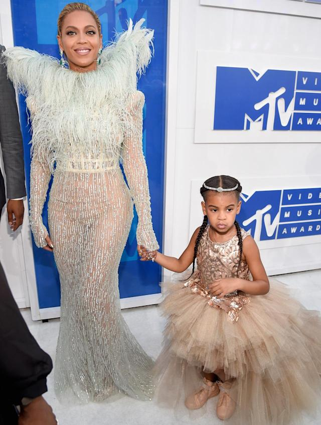 <p>Blue Ivy was back at the VMAs in August 2016 and in high fashion. She was spotting an $11,000 outfit — and that was just the dress. She also had on a diamond tiara and custom hightop sneakers. It was just her second carpet, but she was a pro. (Photo: Kevin Mazur/WireImage) </p>