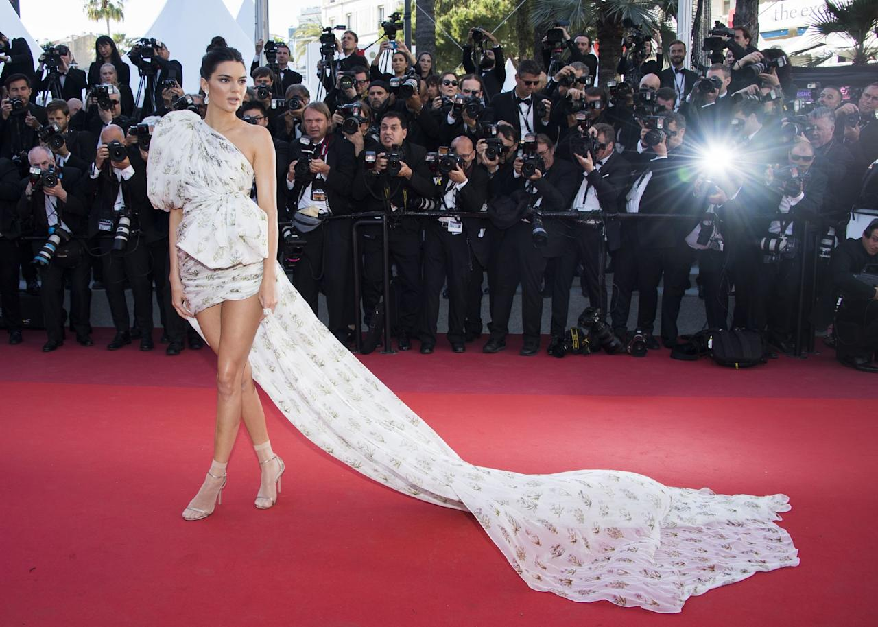 <p>Kendall Jenner turned heads in her distinct dress and accompanying train — to dramatic effect — from Giambattista Valli Couture at the <em>120 Beats Per Minute</em> premiere. (Photo: AP) </p>