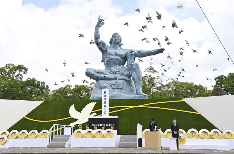 Doves fly over the Peace Statue in Nagasaki's Peace Park during a ceremony commemorating the 75th anniversary of the bombing of the city, in Nagasaki
