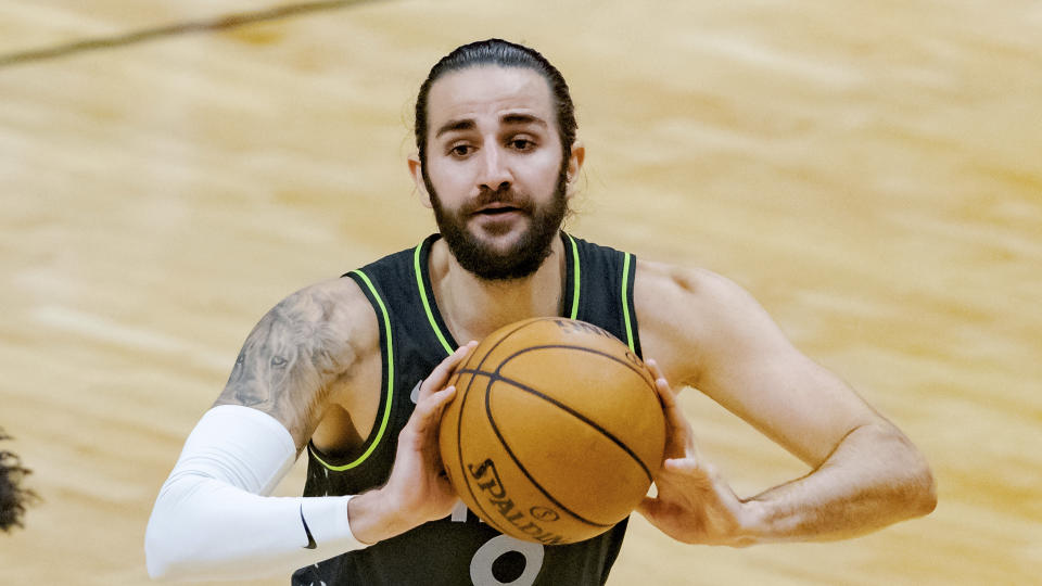 Ricky Rubio looks to pass the ball during a game.