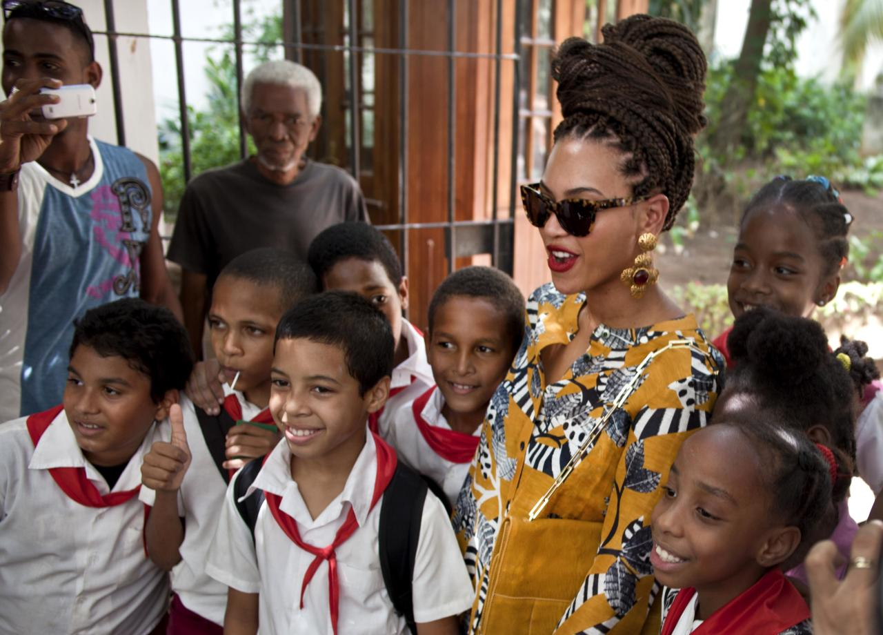 <p> U.S. singer Beyonce poses for photos with school children as she tours Old Havana, Cuba, Thursday, April 4, 2013. Beyonce is in Havana with her husband, rapper Jay-Z, on their fifth wedding anniversary. (AP Photo/Ramon Espinosa)