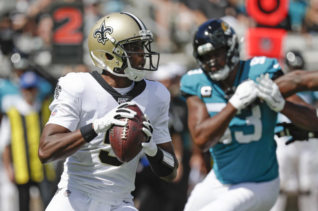 New Orleans Saints quarterback Teddy Bridgewater, left, looks for a receiver as he is pressured by Jacksonville Jaguars defensive end Calais Campbell during the first half of an NFL football game, Sunday, Oct. 13, 2019, in Jacksonville, Fla. (AP Photo/John Raoux)