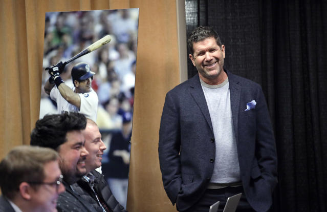 Former Seattle Mariners designated hitter Edgar Martinez smiles as he is introduced at a news conference Tuesday, Jan. 29, 2019, in Seattle. Martinez was elected to baseball's Hall of Fame last week. (AP Photo/Elaine Thompson)