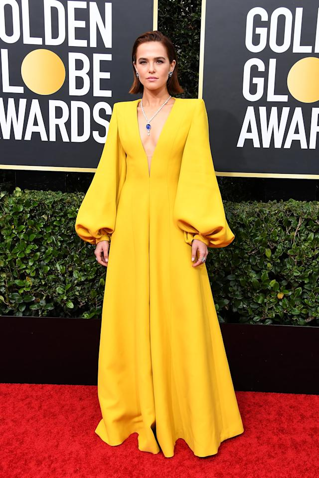 "<p>Wearing <a href=""https://www.popsugar.com.au/fashion/zoey-deutch-fendi-jumpsuit-golden-globes-2020-47068980"" target=""_blank"" class=""ga-track"" data-ga-category=""Related"" data-ga-label=""https://www.popsugar.com.au/fashion/zoey-deutch-fendi-jumpsuit-golden-globes-2020-47068980"" data-ga-action=""In-Line Links"">a bright yellow jumpsuit by Fendi</a>.</p>"