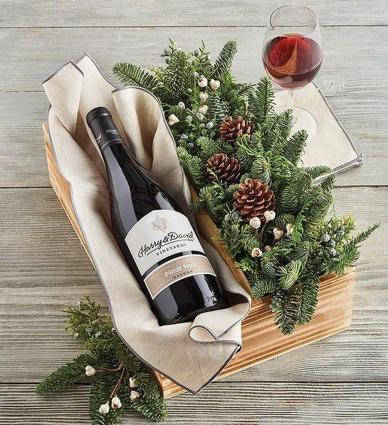 """<h2>Evergreen Centerpiece and Wine Basket</h2><br>Ideal for Christmas, this wine basket arrived beside a pretty noble fir centerpiece in a rustic wooden crate. <br><br><strong><em><a href=""""https://fave.co/3lGyiXK"""" rel=""""nofollow noopener"""" target=""""_blank"""" data-ylk=""""slk:Shop Harry & David"""" class=""""link rapid-noclick-resp"""">Shop Harry & David</a></em></strong> <br><br><strong>Harry & David</strong> Evergreen Centerpiece and Wine Basket, $, available at <a href=""""https://go.skimresources.com/?id=30283X879131&url=https%3A%2F%2Ffave.co%2F3lCSUAe"""" rel=""""nofollow noopener"""" target=""""_blank"""" data-ylk=""""slk:Harry & David"""" class=""""link rapid-noclick-resp"""">Harry & David</a>"""