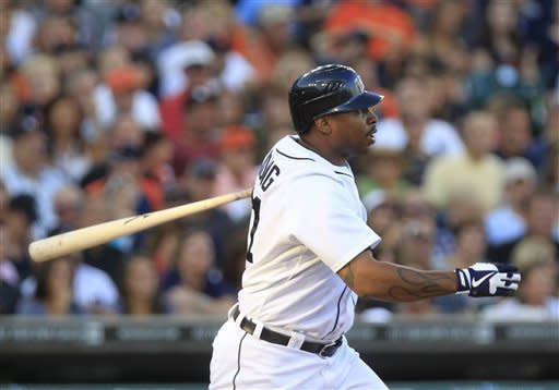 Detroit Tigers designated hitter Delmon Young doubles to deep left center during the third inning of a baseball game against the Chicago White Sox in Detroit, Friday, July 20, 2012. (AP Photo/Carlos Osorio)
