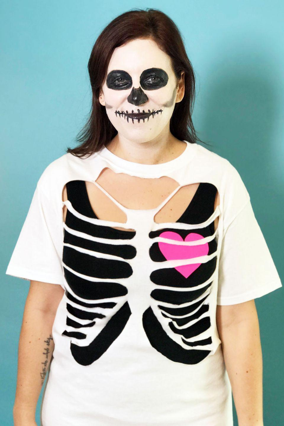 """<p>No high school flashbacks here: This last-minute costume takes a more subtle approach to anatomy. To make, cut out sections of a t-shirt to create a ribcage illusion, add some face paint, and stick on a paper heart for an especially adorable skeleton.</p><p><a class=""""link rapid-noclick-resp"""" href=""""https://www.amazon.com/Costumes-Occasions-DD451-Palette-Skeleton/dp/B000LNGBN6/?tag=syn-yahoo-20&ascsubtag=%5Bartid%7C10055.g.2750%5Bsrc%7Cyahoo-us"""" rel=""""nofollow noopener"""" target=""""_blank"""" data-ylk=""""slk:SHOP SKELETON MAKEUP KITS"""">SHOP SKELETON MAKEUP KITS</a></p><p><strong>RELATED:</strong> <a href=""""https://www.goodhousekeeping.com/holidays/halloween-ideas/a28088746/skeleton-face-paint-tutorial/"""" rel=""""nofollow noopener"""" target=""""_blank"""" data-ylk=""""slk:This Easy Skeleton Face Paint Tutorial Only Takes 10 Minutes"""" class=""""link rapid-noclick-resp"""">This Easy Skeleton Face Paint Tutorial Only Takes 10 Minutes</a></p>"""