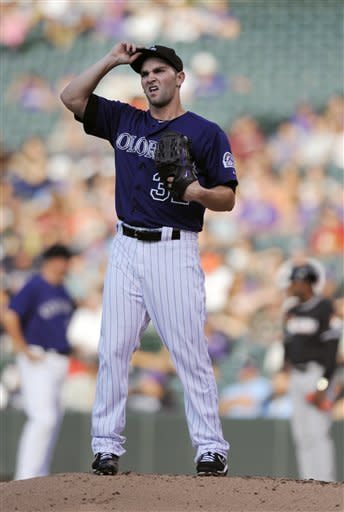 Colorado Rockies starting pitcher Tyler Chatwood grimaces after giving up a three-run home run in the first inning of a baseball game against the Miami Marlins in Denver on Saturday, Aug. 18, 2012. (AP Photo/Chris Schneider)