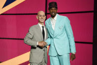 Evan Mobley, right, poses for a photo with NBA Commissioner Adam Silver after being selected third overall by the Cleveland Cavaliers during the NBA basketball draft, Thursday, July 29, 2021, in New York. (AP Photo/Corey Sipkin)