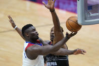 New Orleans Pelicans forward Zion Williamson drives to the basket against Philadelphia 76ers center Dwight Howard in the second half of an NBA basketball game in New Orleans, Friday, April 9, 2021. The Pelicans won 101-94. (AP Photo/Gerald Herbert)