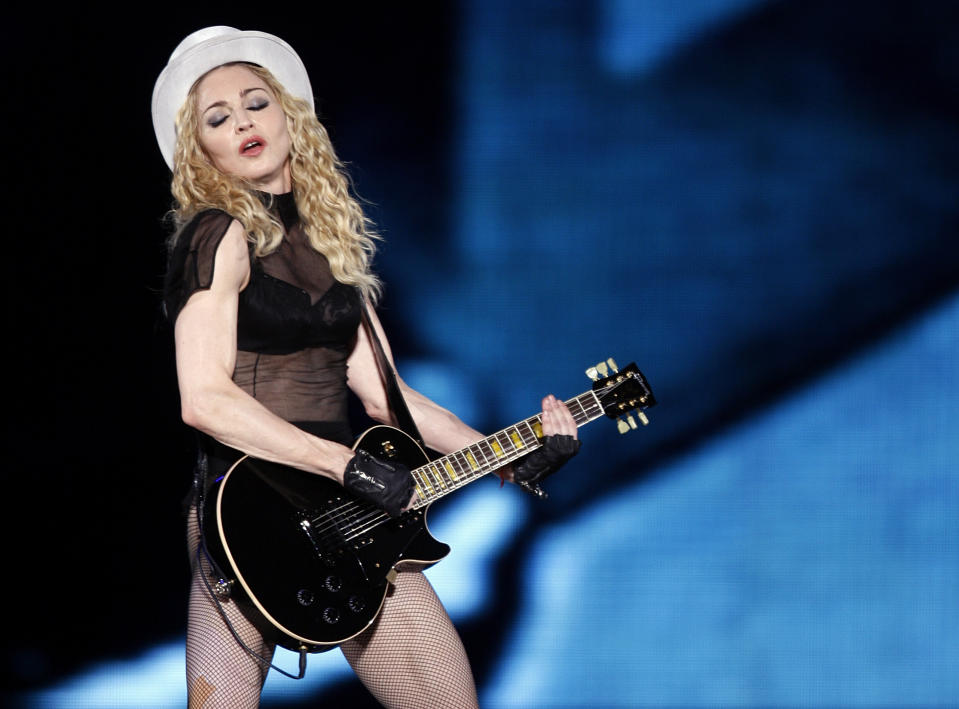 """U.S. singer Madonna performs on stage during her """"Sticky and Sweet"""" tour at Monumental stadium in Buenos Aires, December 5, 2008. REUTERS/Marcos Brindicci (ARGENTINA)"""