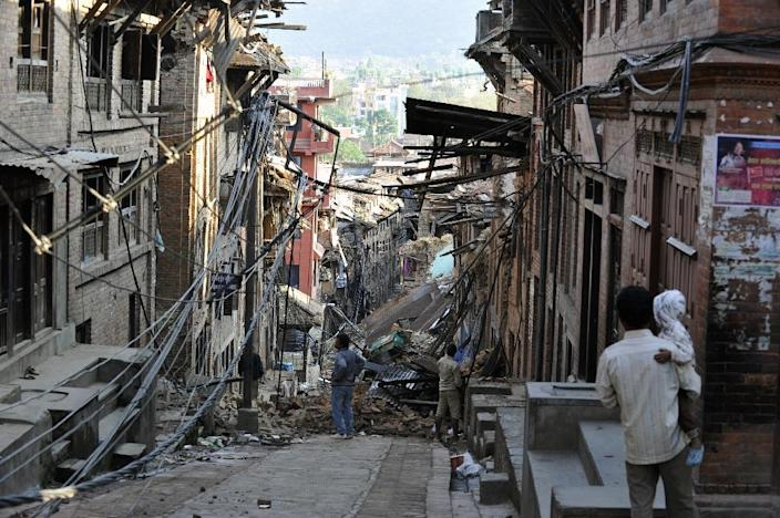 Nepal says 5,057 people were killed by the devastating earthquake which also claimed the lives of more than 100 people died in neighbouring countries such as India and China (AFP Photo/Prakash Mathema)