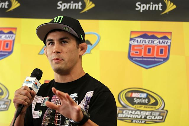 AVONDALE, AZ - NOVEMBER 11: Ultimate Fighting Championship Bantamweight fighter Dominick Cruz speaks to the media prior to the NASCAR Sprint Cup Series AdvoCare 500 at Phoenix International Raceway on November 11, 2012 in Avondale, Arizona. (Photo by Todd Warshaw/Getty Images for NASCAR)