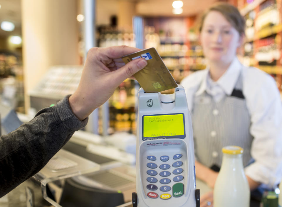Credit card interest rates are at a 25 year high and pinching American wallets. (Photo: Ute Gabrowsky/Getty Images)