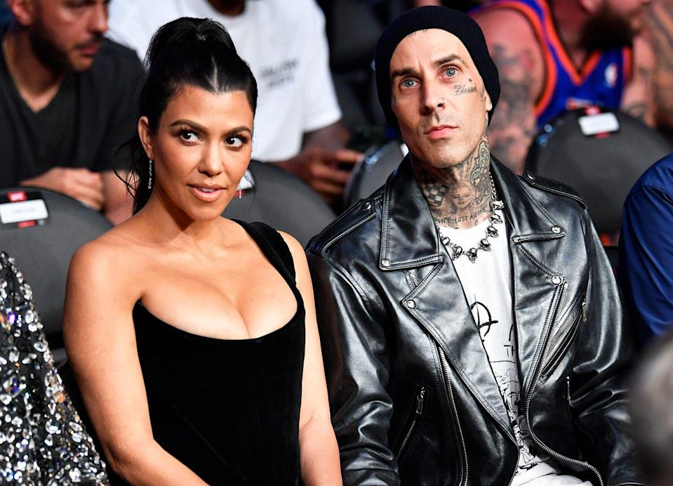 Kourtney Kardashian and Travis Barker are seen in attendance during the UFC 264 event at T-Mobile Arena on July 10, 2021 in Las Vegas, Nevada.