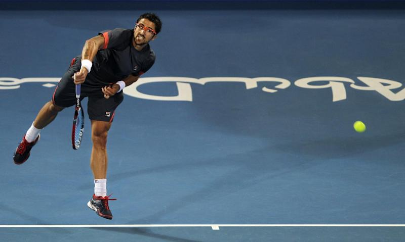 Serbia's Janko Tipsarevic serves the ball to Andy Murray from Britain during the first day of Mubadala Tennis Championship in Abu Dhabi, United Arab Emirates, Thursday, Dec. 27, 2012. (AP Photo/Kamran Jebreili)
