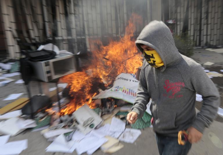 Protesters set fire to the Education Secretararyship's Finance Office in Chilpancingo, Guerrero State on November 12, 2014