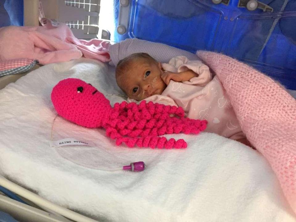 Jasmine Smith-Leach cuddles her crochet octopus. The toy helps provide comfort to preemies. <em>(Photo: Poole Hospital)</em>