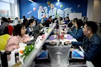Blued parent company BlueCity's sunlit Beijing campus teems with young programmers who hold meetings in rooms named after Oscar Wilde and other prominent LGBTQ figures