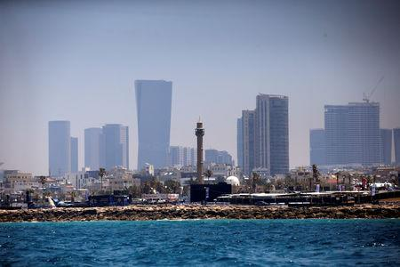 FILE PHOTO: The minaret of the Hassan Bek Mosque is seen behind the Eurovision Village, an area for fans of the 2019 Eurovision Song Contest, as seen from the Mediterranean Sea off the coast of Tel Aviv, Israel May 12, 2019. REUTERS/Ronen Zvulun/File Photo